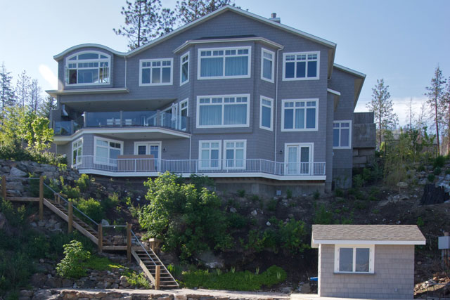 Lakeview terrace custom home on steep lot with lake views for Lake house plans for steep lots
