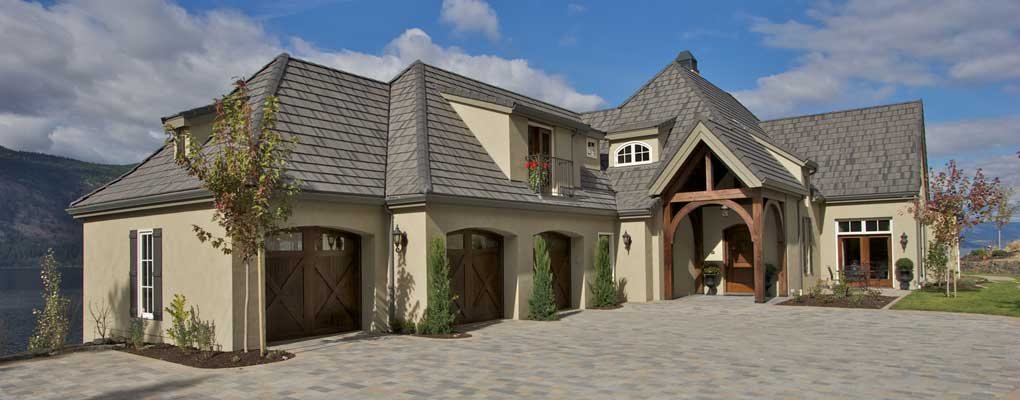 french country styled custom home on steep hillside property on a house built into steep slope designs, patio home designs, building on a slope designs, steep land, hill green home designs, fence on slope designs, backyard deck designs, steep lot house designs, hillside deck designs, houses on hillsides designs, modern ranch home designs,